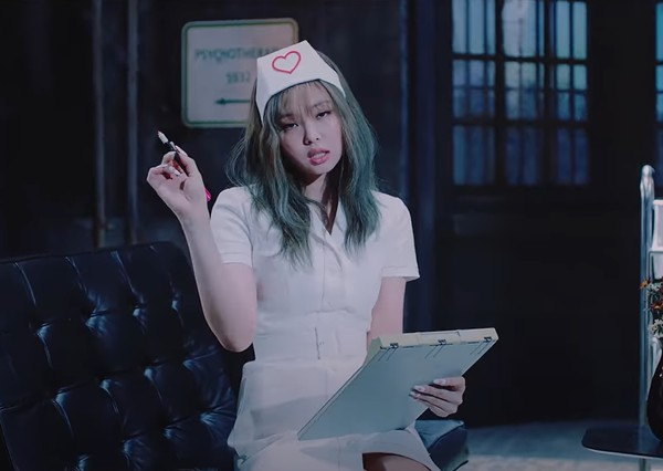 "A scene of K-pop group Blackpink's music video of the new song ""Lovesick Girls"" portrays a nurse wearing a nurse cap and a tight, short skirt. (Captured from YouTube)"